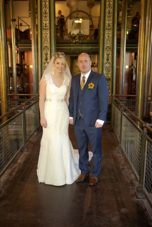 Bride and groom standing inside papplewick pumping station's pumping house
