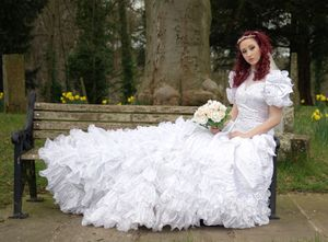 Young bride sat on a bench at Annersley derelict church