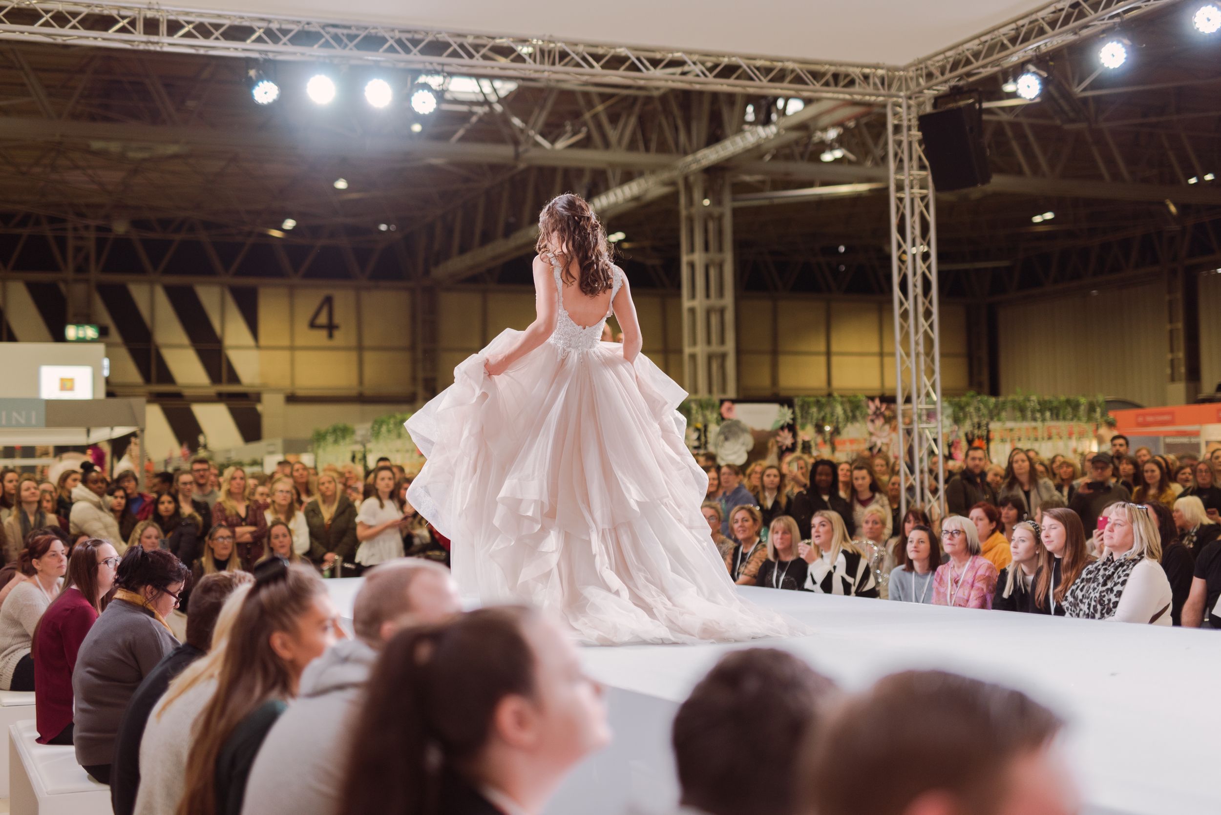 Bridal show catwalk model on runway Birmingham NEC