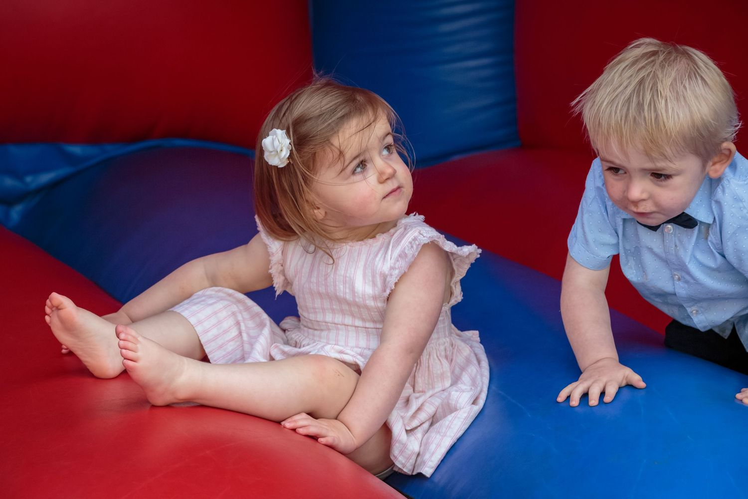 young girl and boy on the bouncy castle in the gardens at west tower