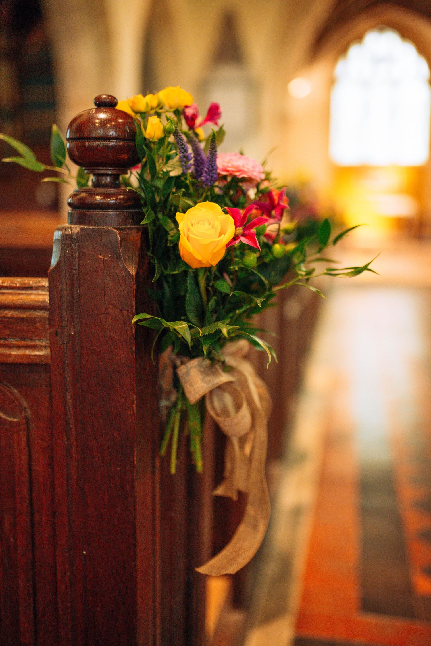 Elmore wedding by Zara Davis Photography, Gloucestershire flowers on the pew
