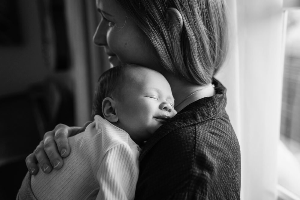 Mother and newborn baby relaxed in home lifestyle photography