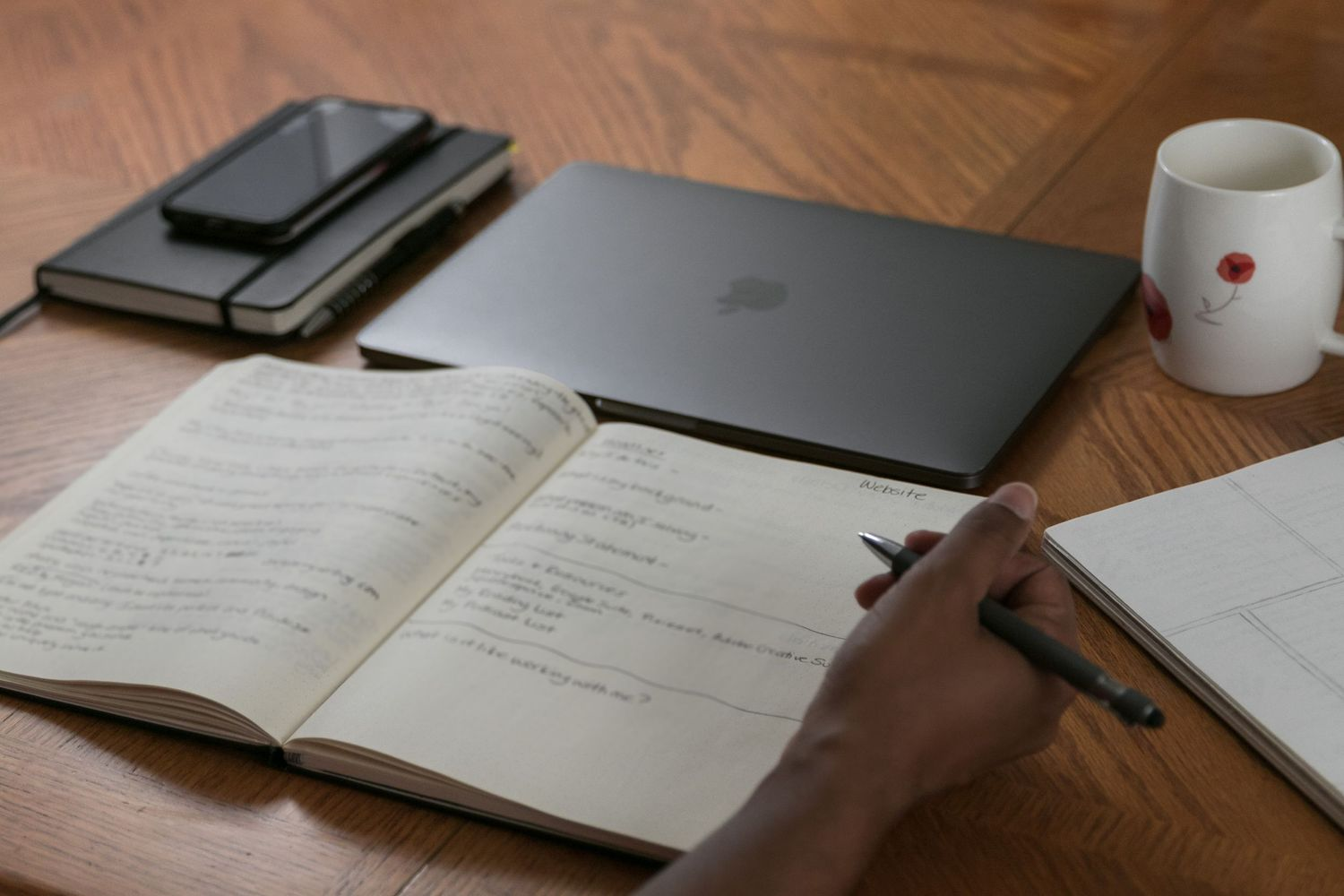 Workspace image of a woman preparing for a meeting with a client.