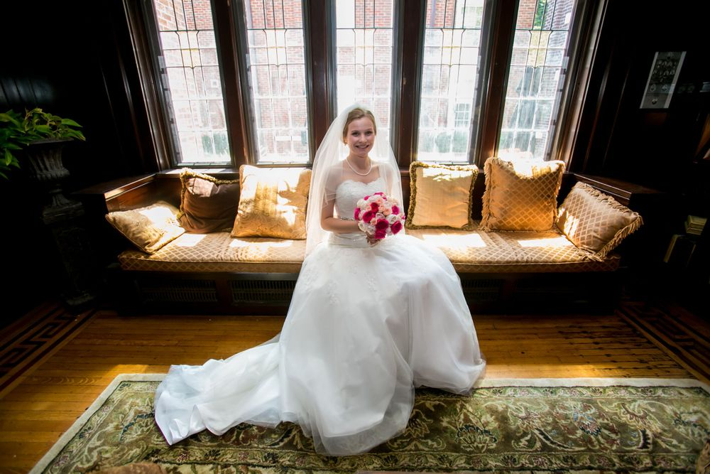 Kelsey poses before her wedding in her bridal gown at Graduate Columbia Hotel in Columbia, SC.