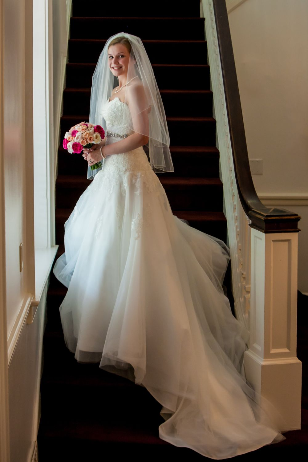 Kelsey poses before her wedding on the staircase at USC's Rutledge Chapel in Columbia, SC.