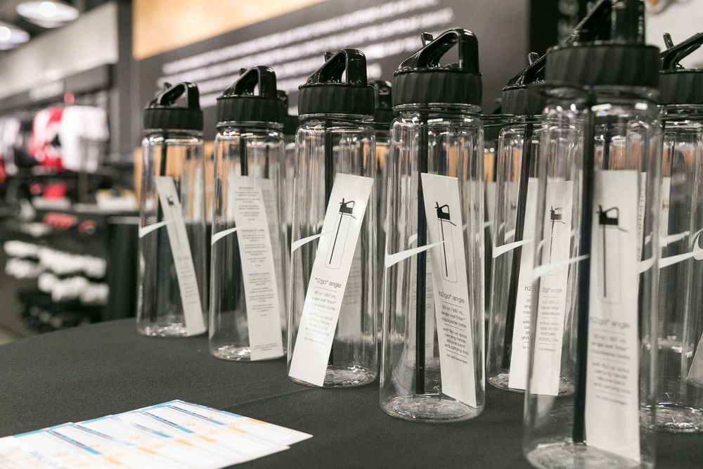 Nike water bottle favors displayed on a table for event attendees to take home.