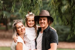A beautiful moment captured during a family photo session in Berwick's Wilson Botanic Park.