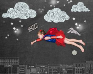 Little girl is a flying superhero in this great chalkboard photography session.
