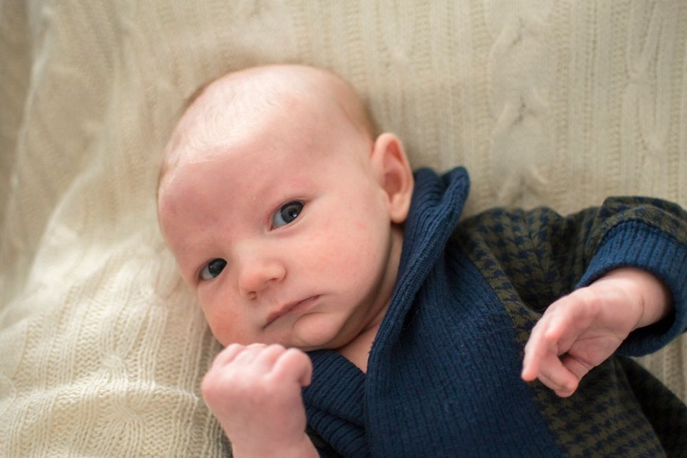 Baby looking at camera, seemingly ready to punch a right hook