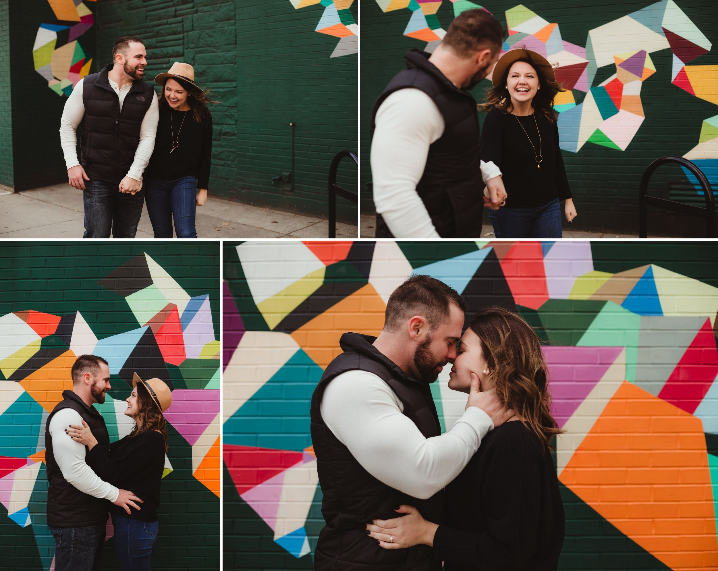 Man and woman hold hands, smiling at each other, and embrace in front of a brightly colored mural.