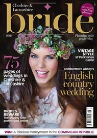 Front cover of Cheshire and Lancashire bride magazine of a smiling bride and features wedding photography by Paul Baybut