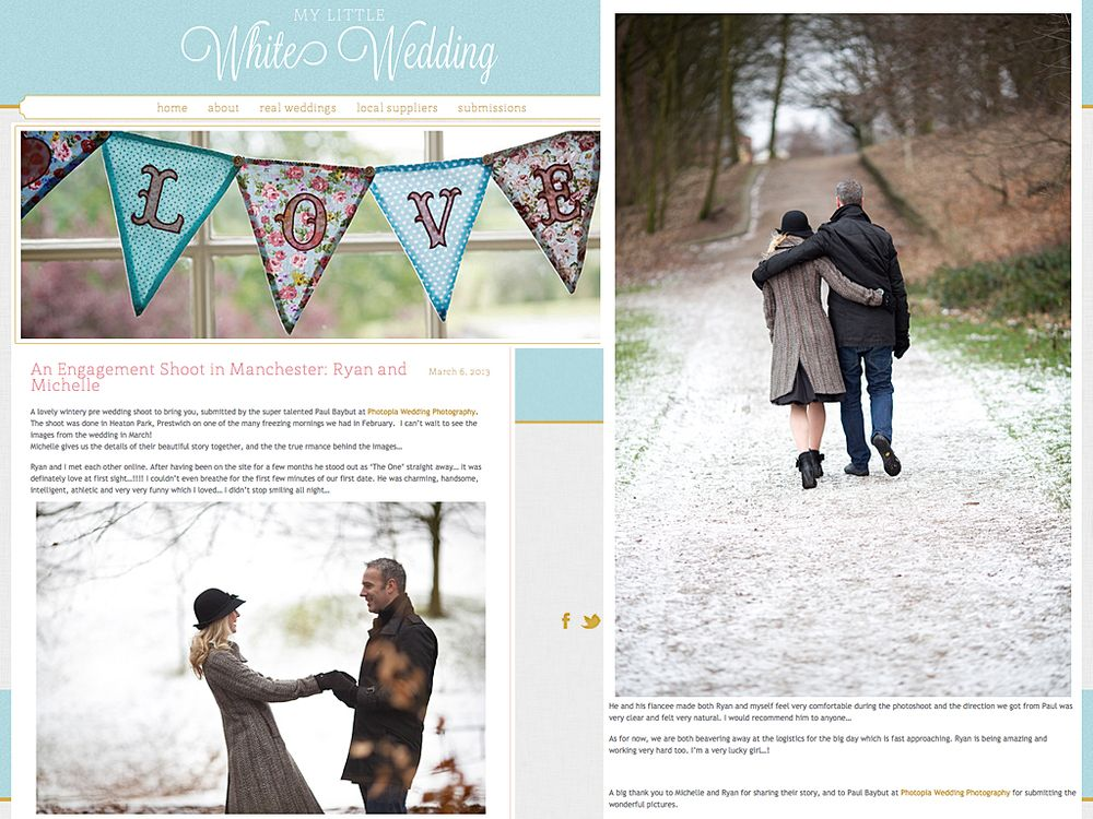 A young couple walk and embrace on a snowy winters day in the park on their engagement photography shoot by Paul Baybut