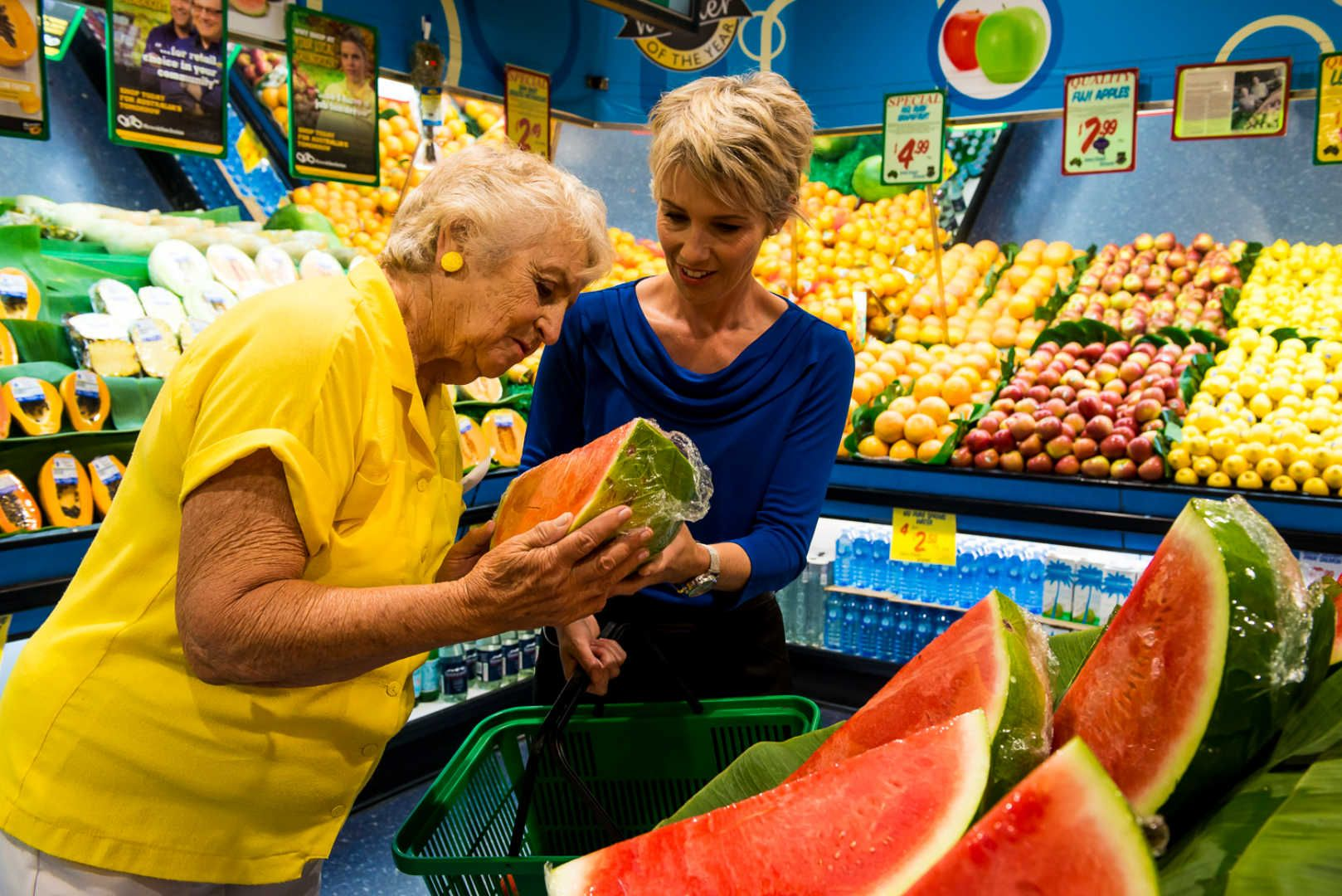 elderly woman and her carer shopping