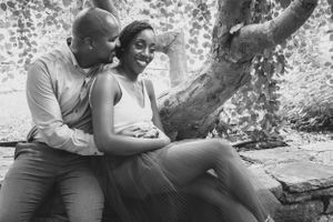 Happy couple sharing a laugh and embrace during Harvard Arnold arboretum engagement photoshoot