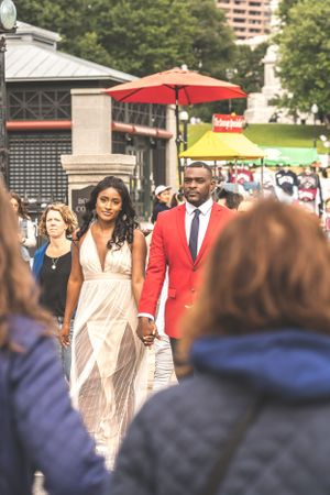 breathtaking photo of couple in crosswalk during rush hour engagement photoshoot