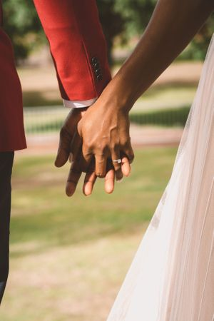 Boston couple holding hands in the Boston commons for romantic engagement shoot