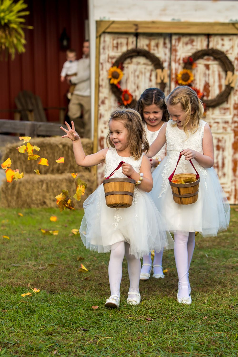 Flower girls drop petals as they walk down the aisle during a wedding at T&S Farm in Leesville, SC