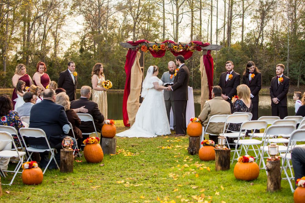 Bride Becca and groom Kyle exchange vows during a wedding at T&S Farm in Leesville, SC