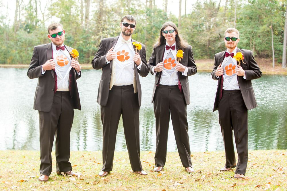 Kyle and his groomsmen show their Clemson Tiger Paws under their tuxedos before a wedding at T&S Farm in Leesville, SC