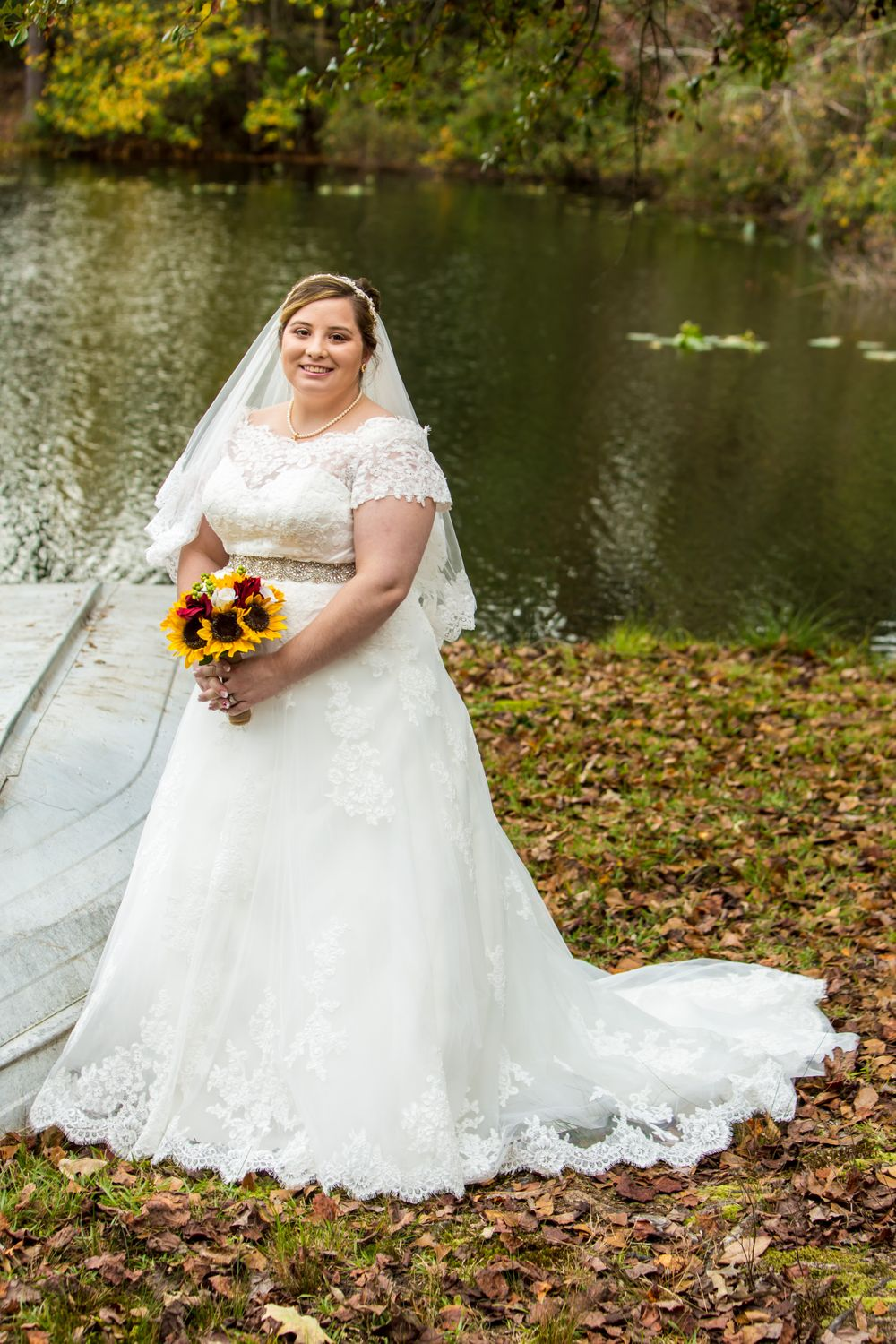 Bride Becca poses for her bridal portrait at the pond before a wedding at T&S Farm in Leesville, SC
