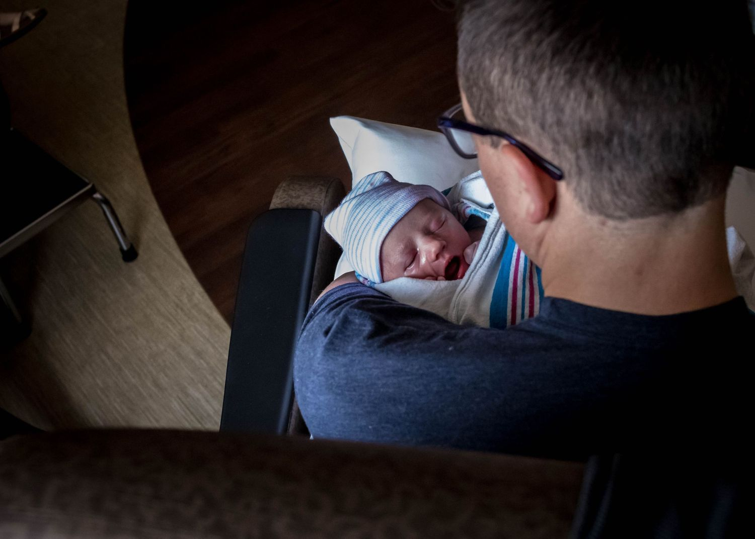 Dad holding his newborn baby girl just after birth in Sioux City, IA.