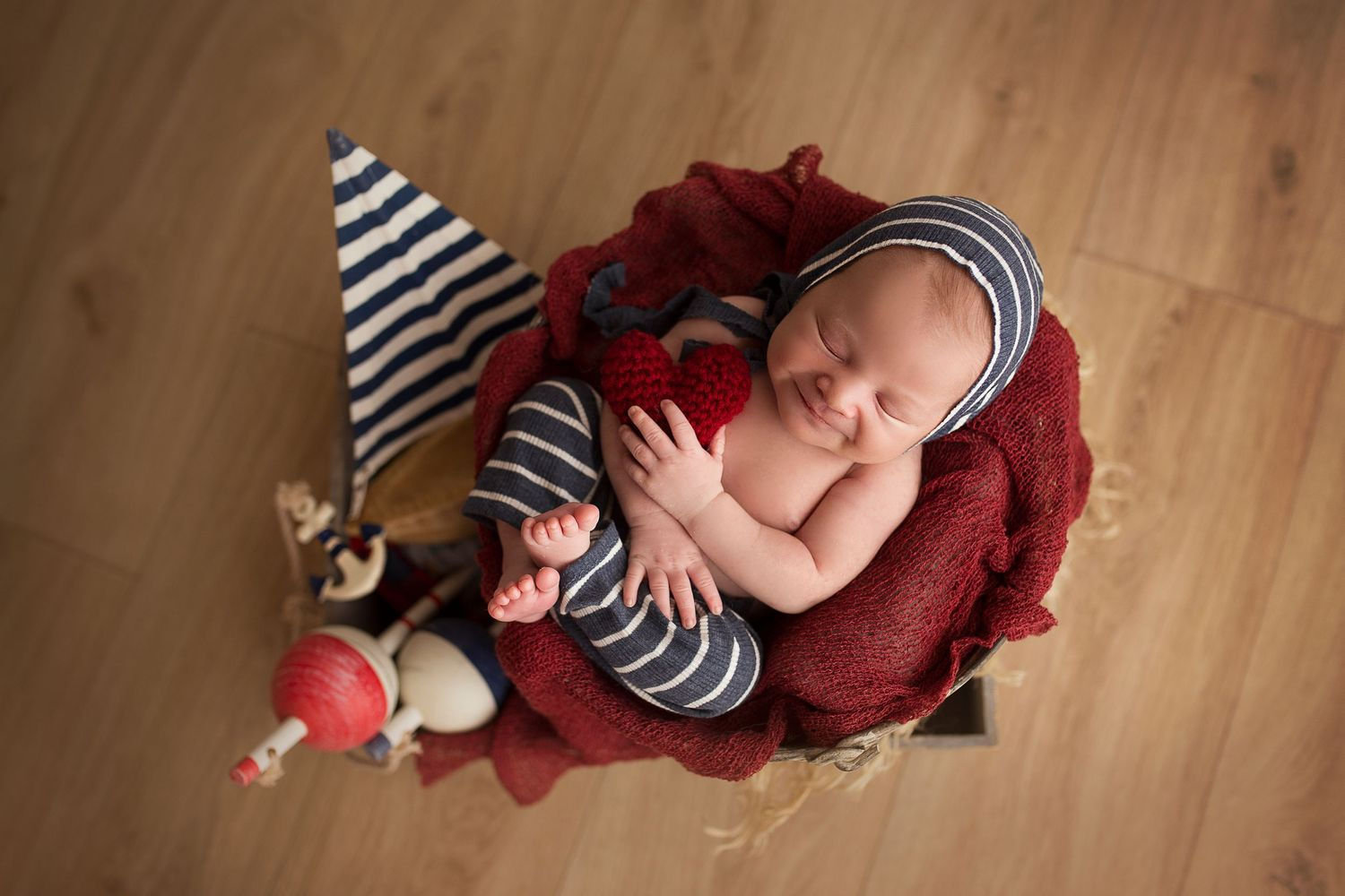 smiling newborn baby boy cute babies laying in bucket detres