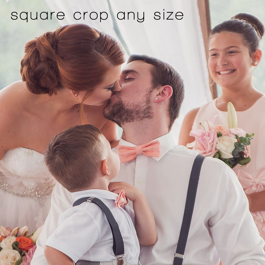 bride and groom kissing while children look on