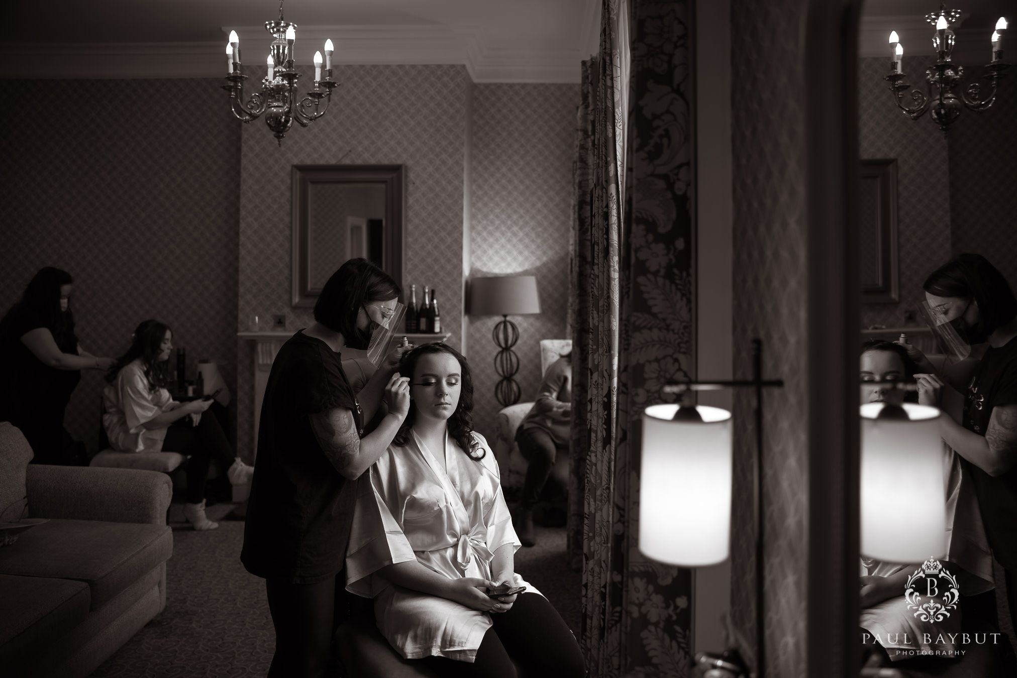 Mottram Hall wedding blog photography of bridesmaid getting ready during bridal prep