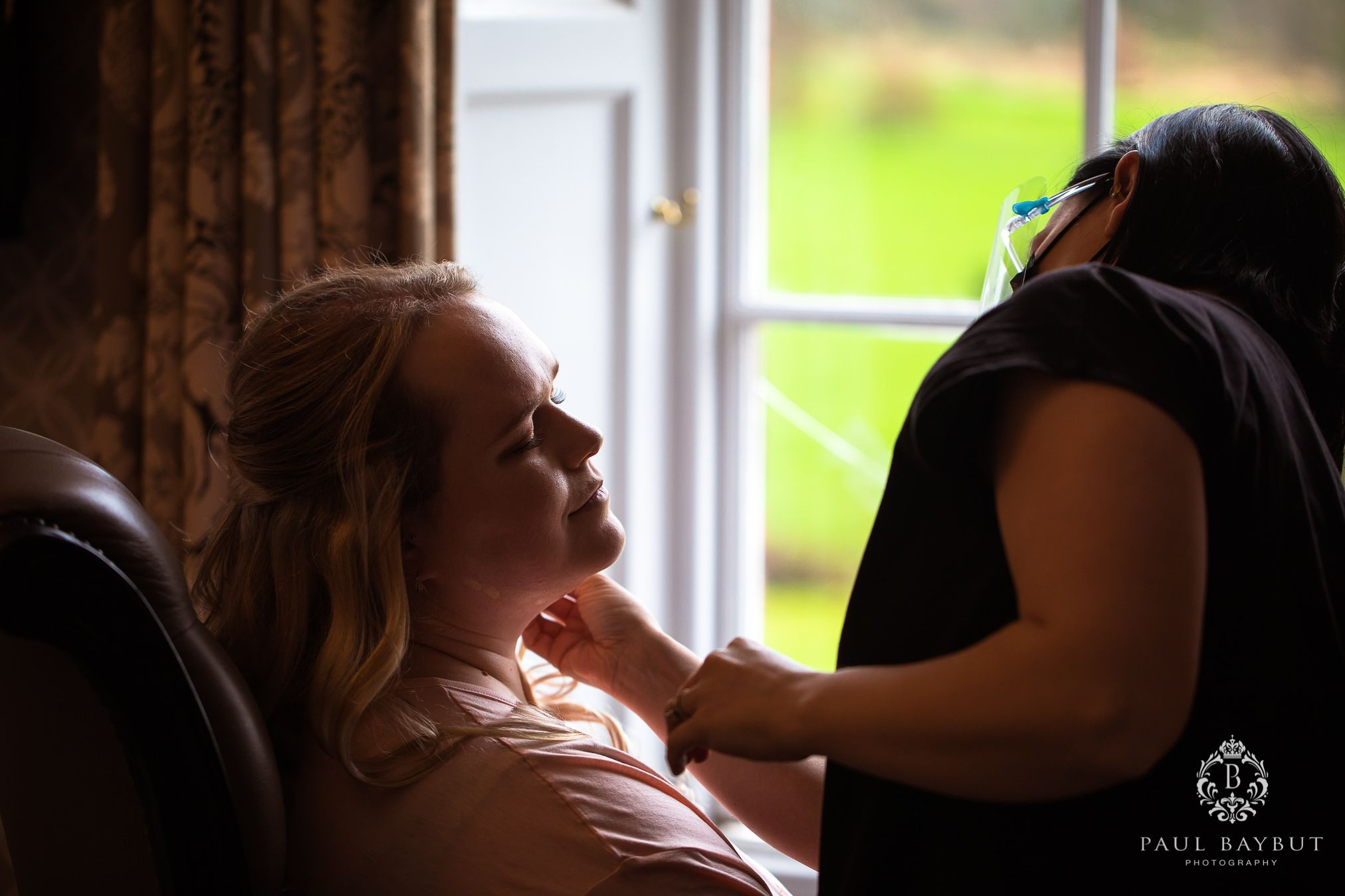 Bride getting ready during bridal prep at Mottram Hall wedding