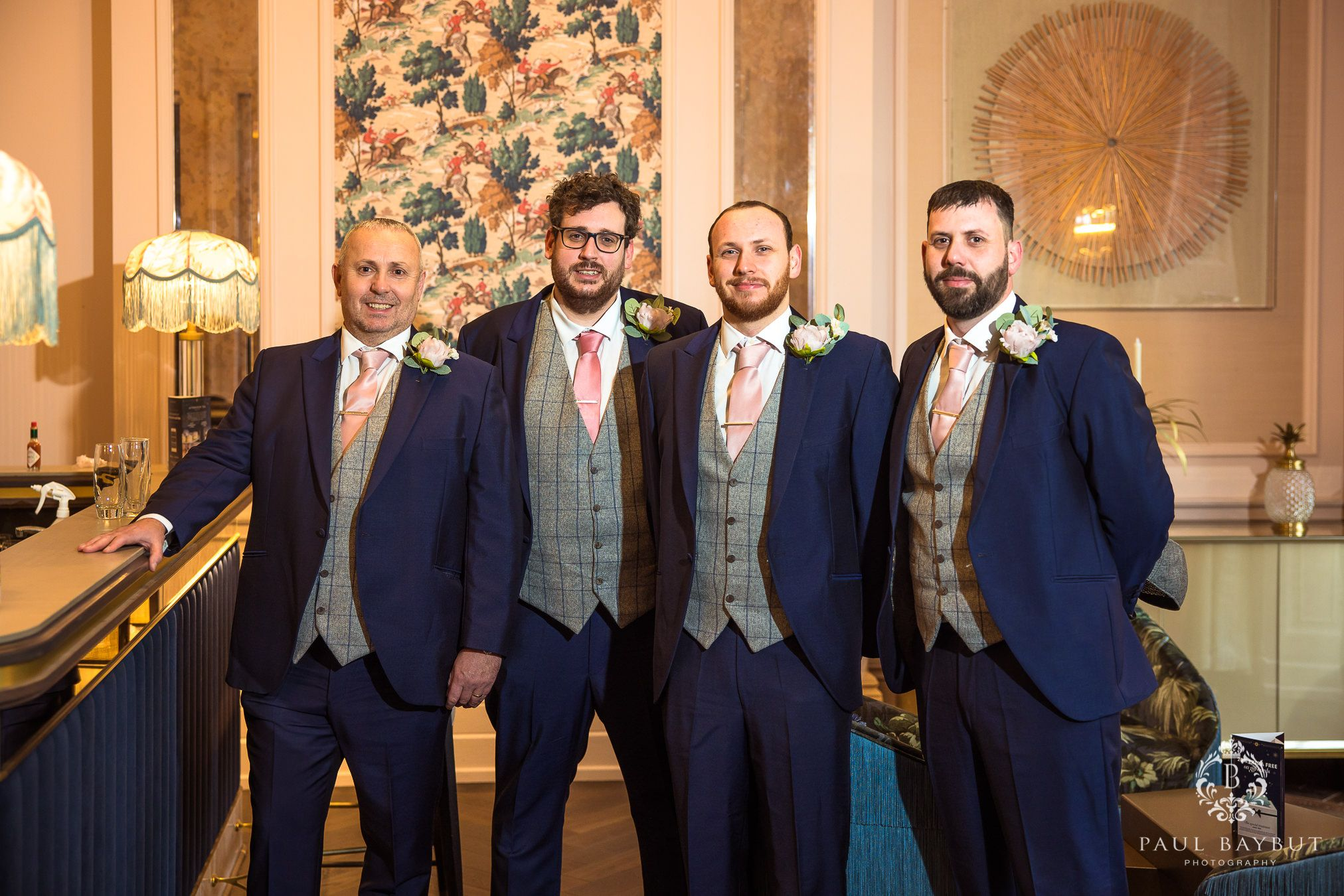 Groom and groomsmen at Mottram Hall pose for a photo by Manchester wedding photographer Paul Baybut