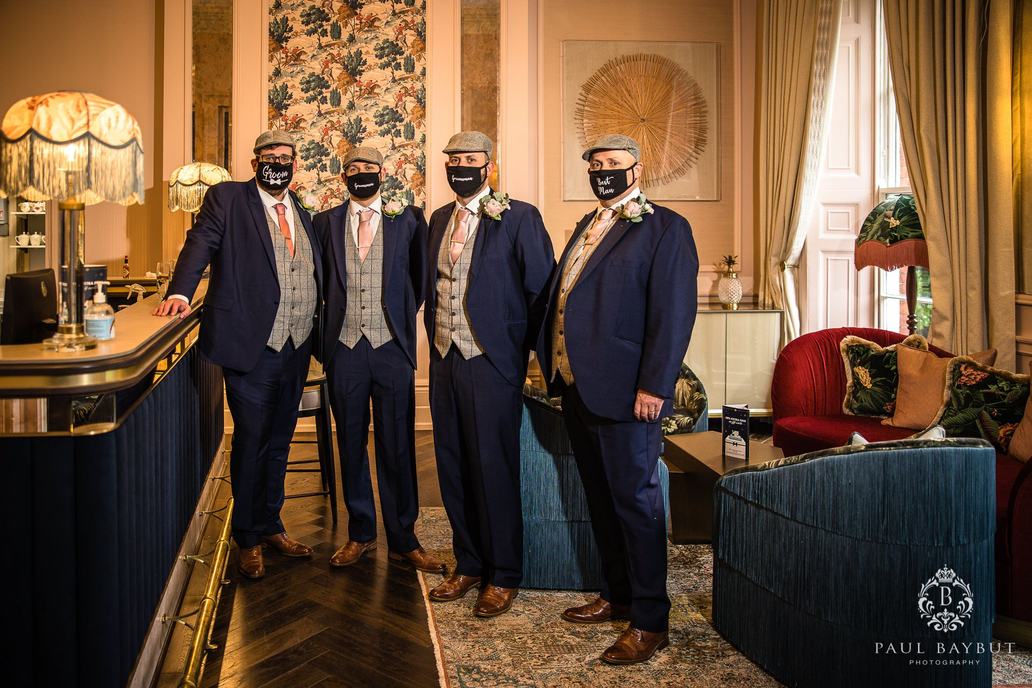 Groom and groomsmen wearing a covid masks at Mottram Hall wedding venue Christmas wedding