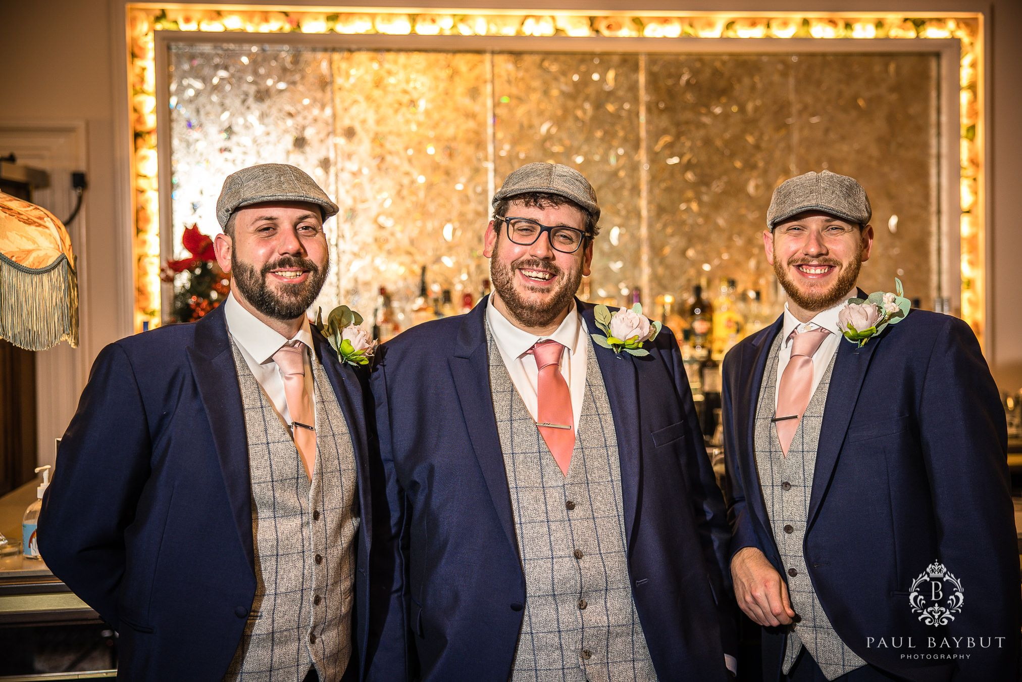 Smiling groom and groomsmen at Mottram Hall pose for a photo by Manchester wedding photographer Paul Baybut