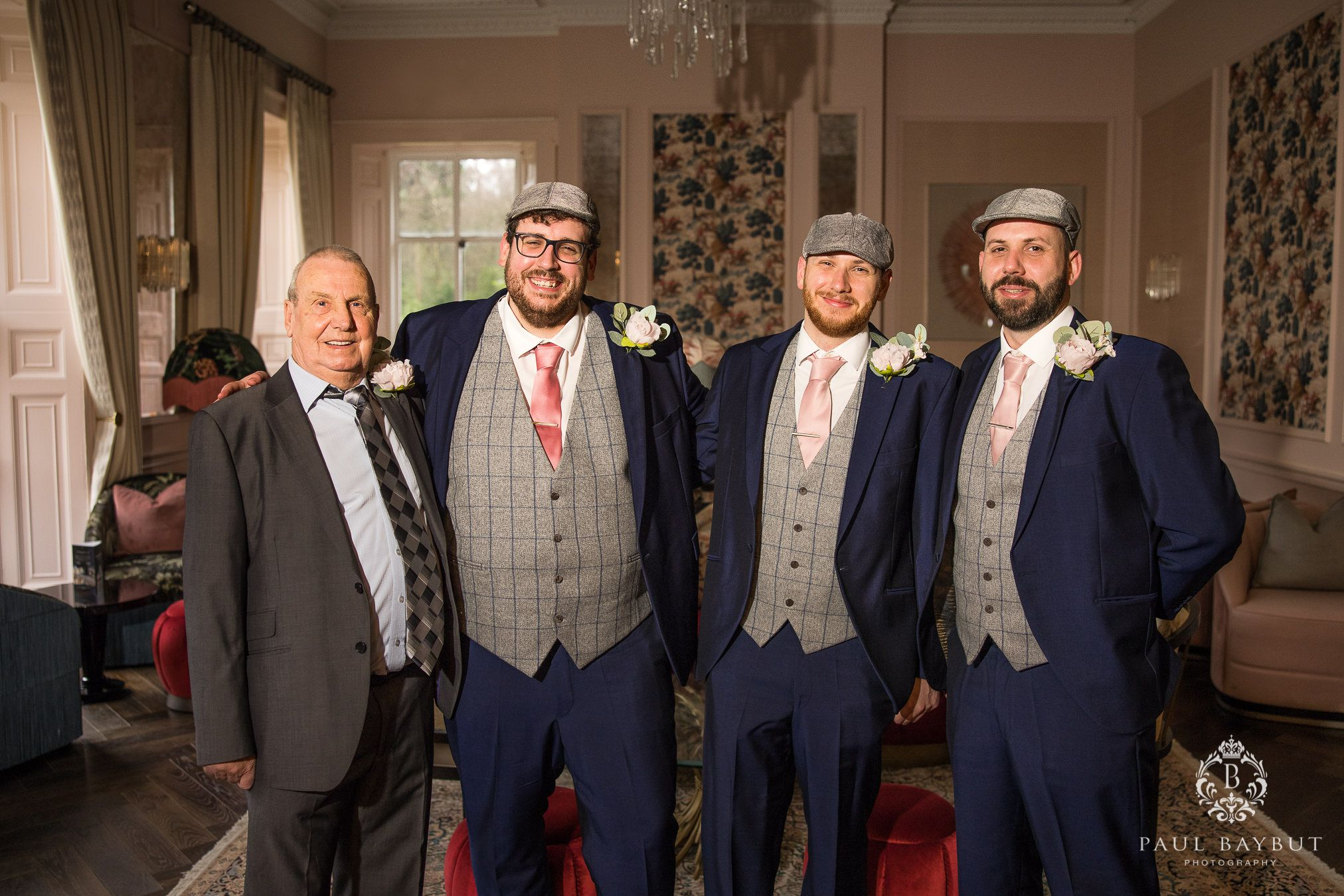 All the men standing for wedding photos at Mottram Hall Winter wedding