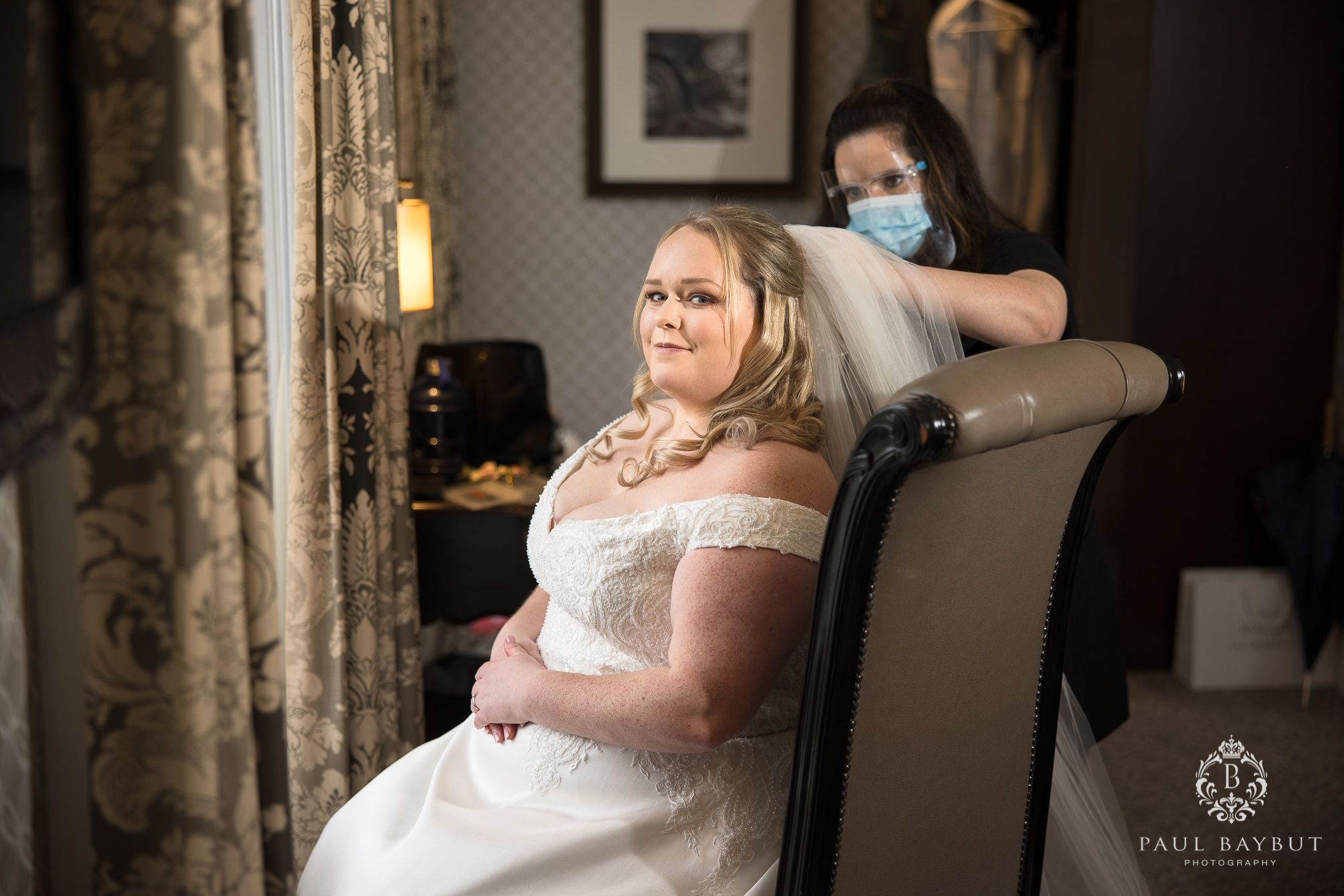 Cheshire wedding photographer at Mottram Hall with bride at bridal prep