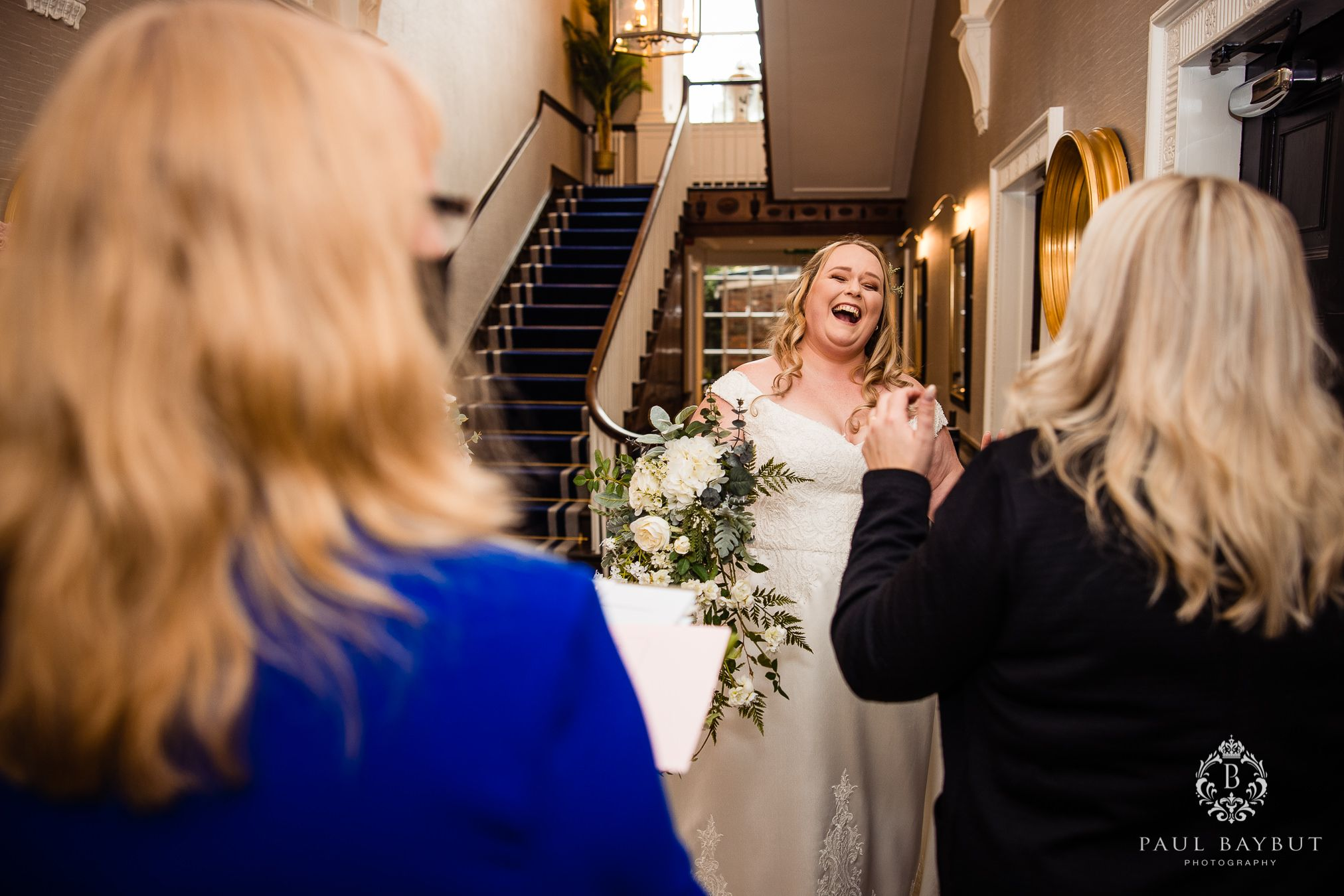 Mottram Hall wedding venue bride laughing with joy at her Winter wedding