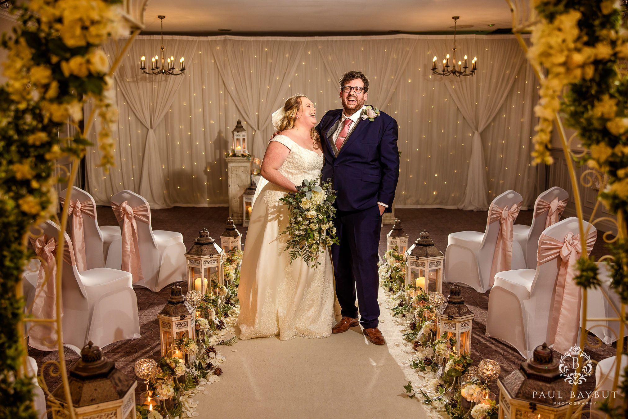 Winter wedding photography at Mottram Hall of bride and groom after their festive ceremony