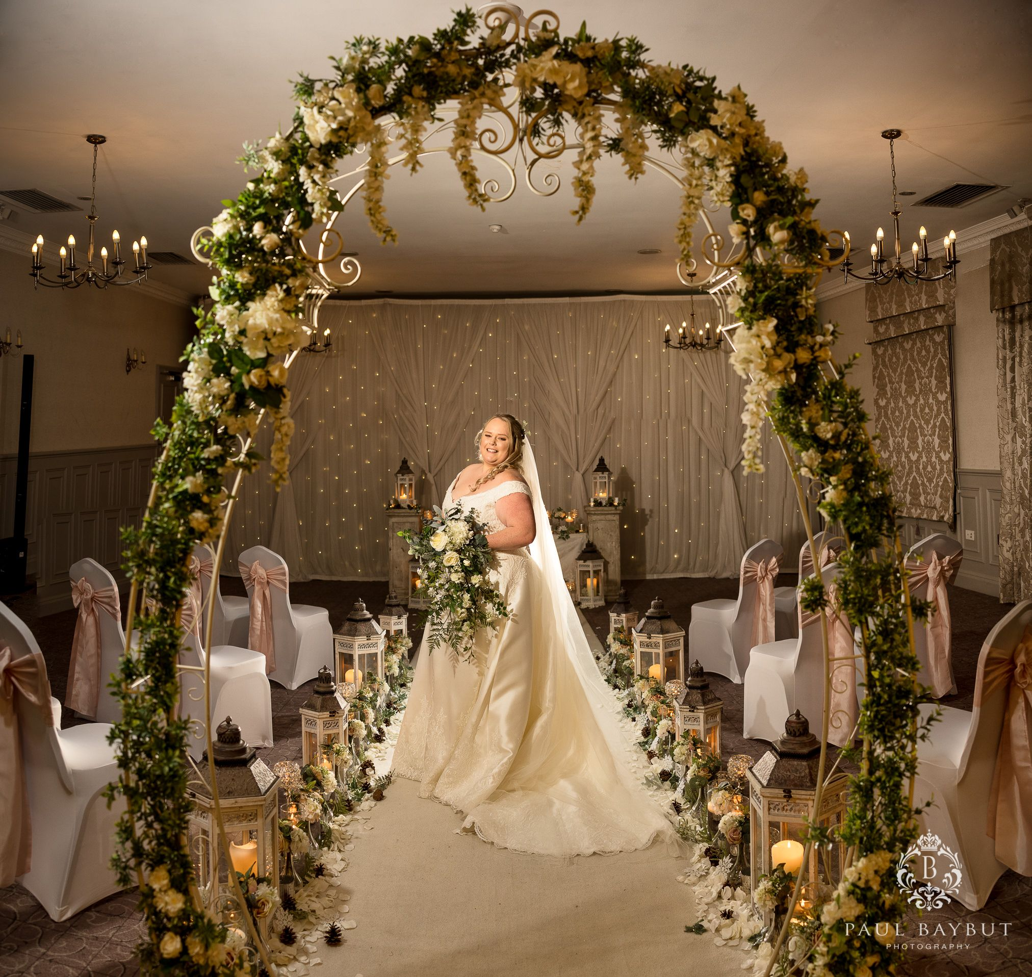 Winter wedding photography at Mottram Hall of bride posing after the ceremony