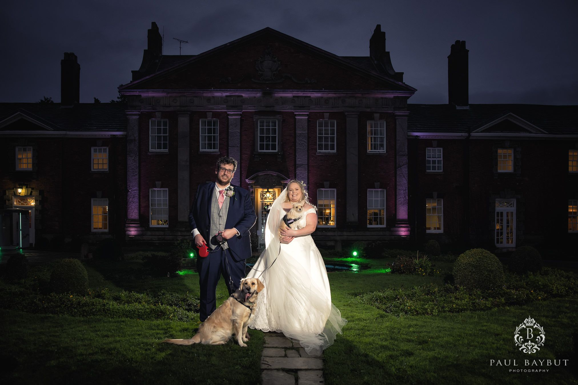 Mottram Hall wedding venue bride and groom outisde with their two dogs