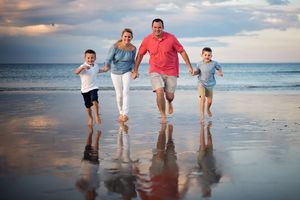 plymouth, ma | family beach portraits | heidi harting photography | fun family running on the beach with reflection