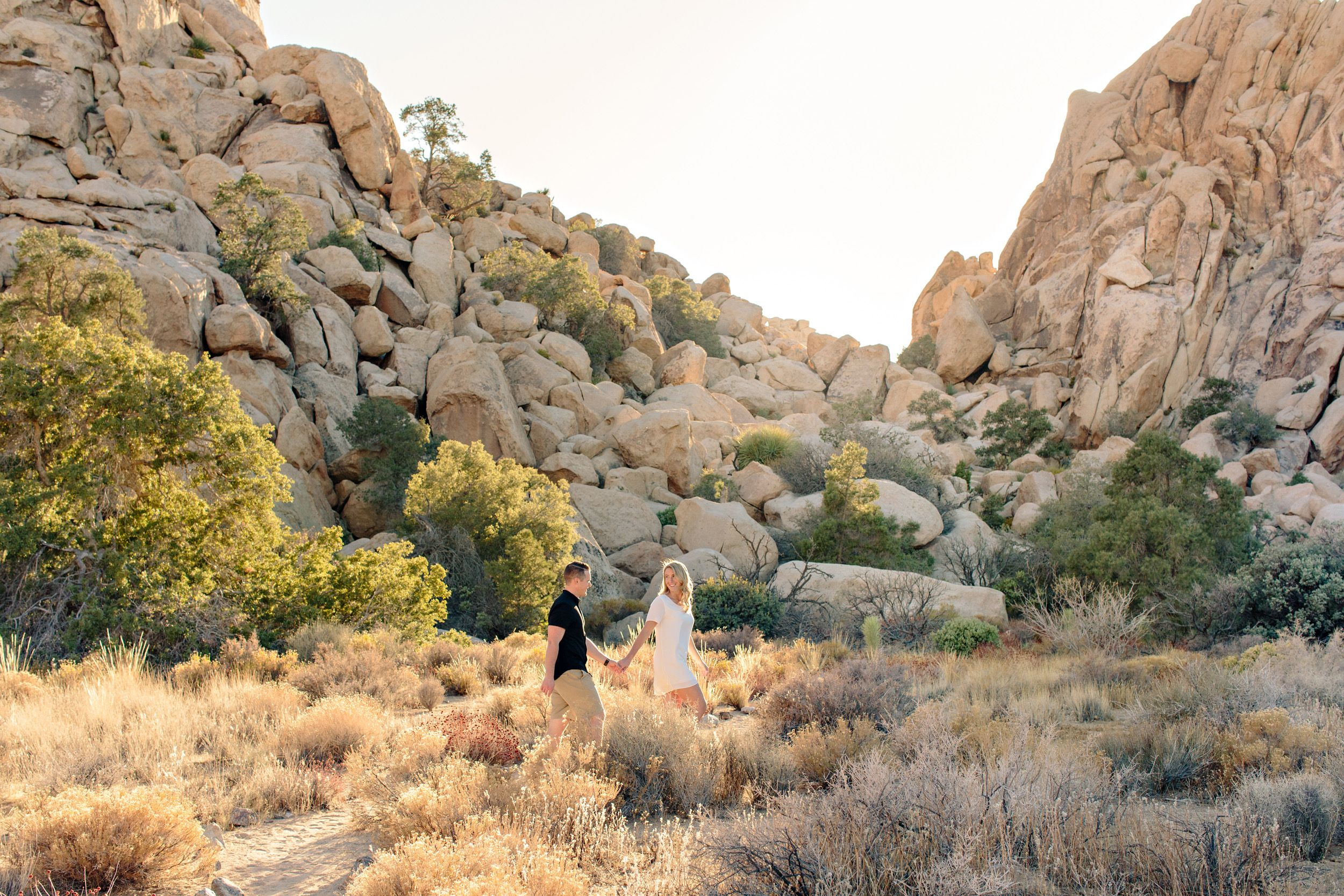 couple walking at joshua tree national park