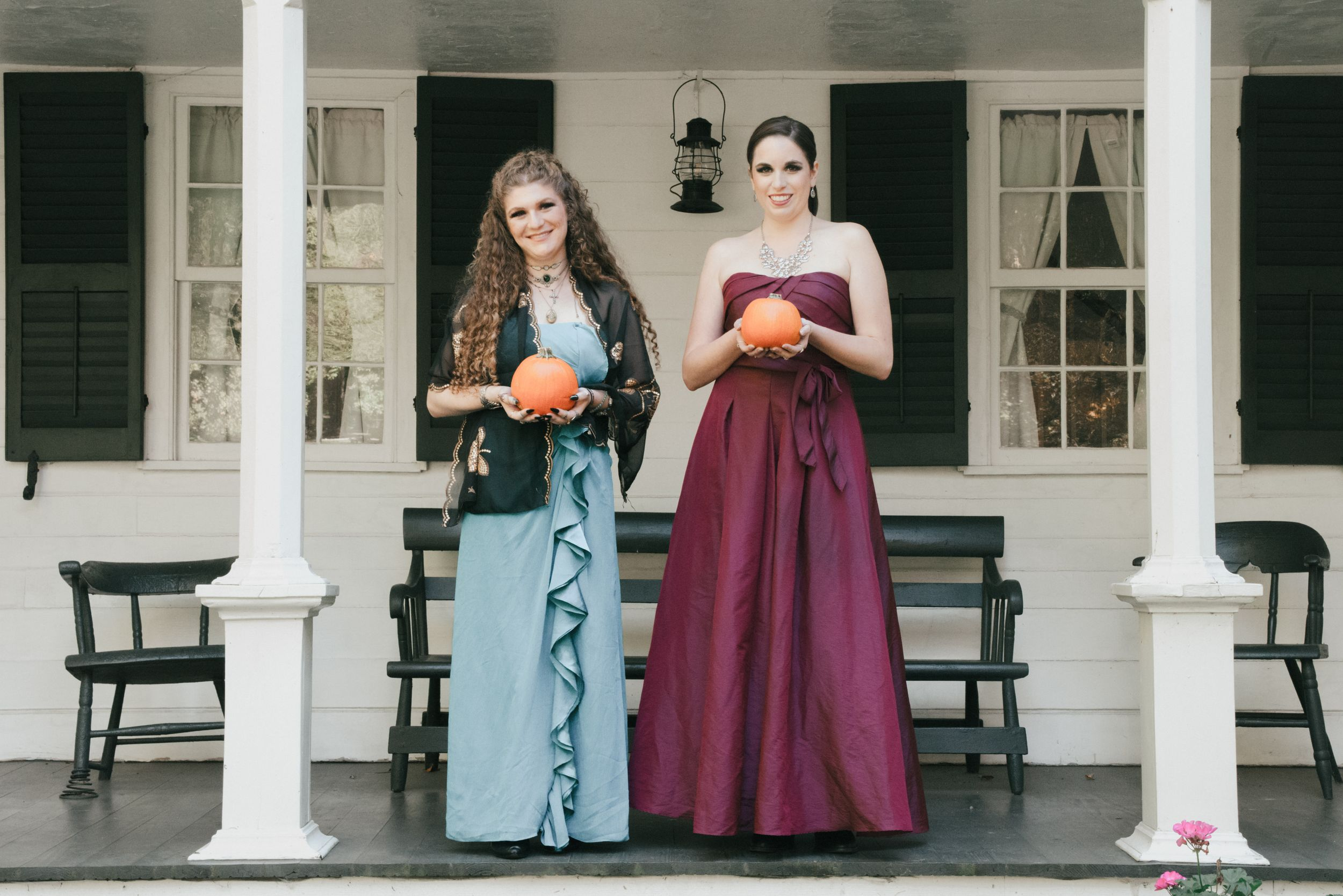 two brides holding pumpkins fall wedding , LGBT wedding in Ohio