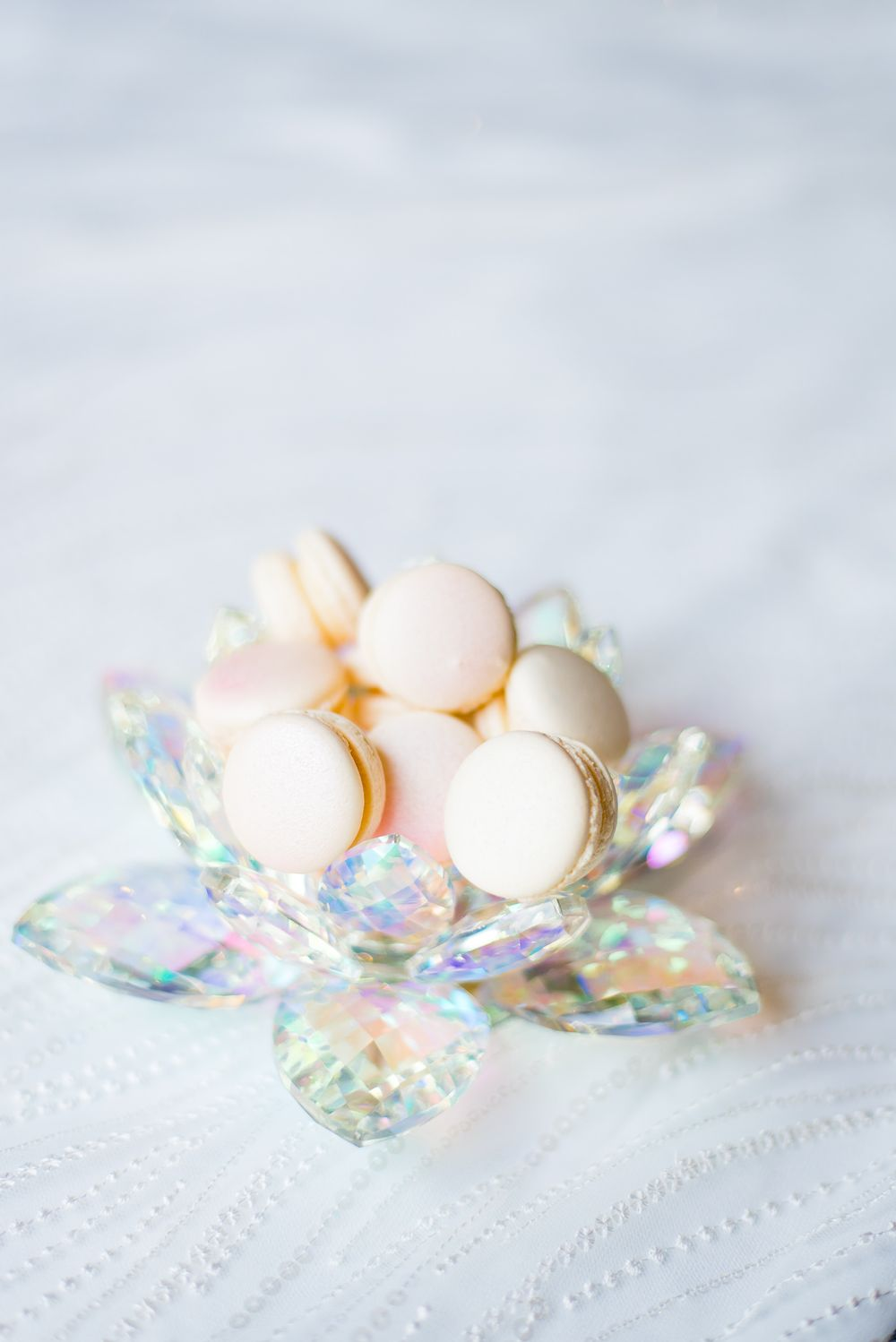 iridescent pale pink macarons in a crystal iridescent bowl