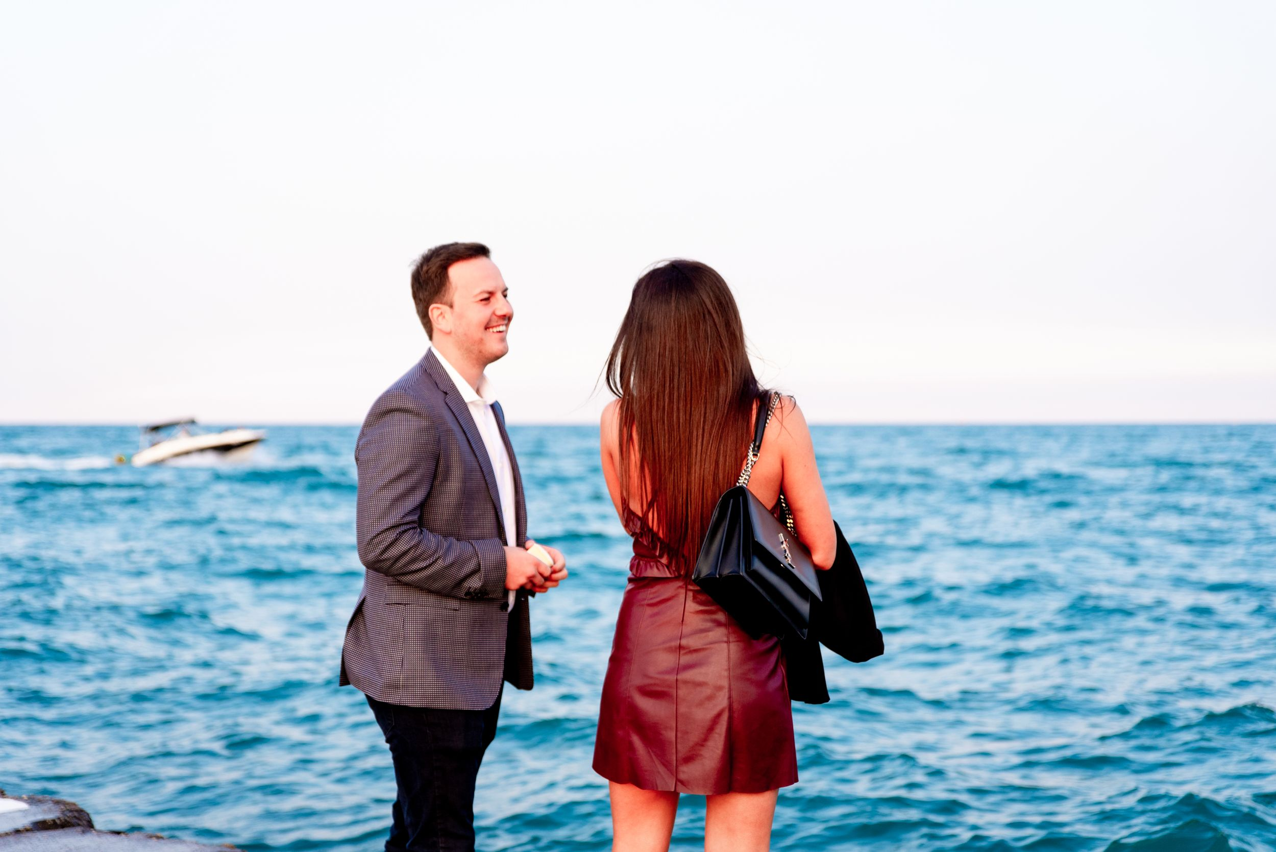 man smiling at his girlfriend before North Avenue Beach Proposal