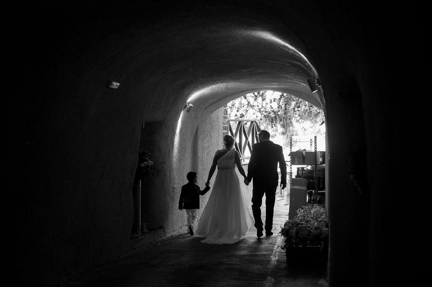 back of bride with her brother and nephew walking down the aisle