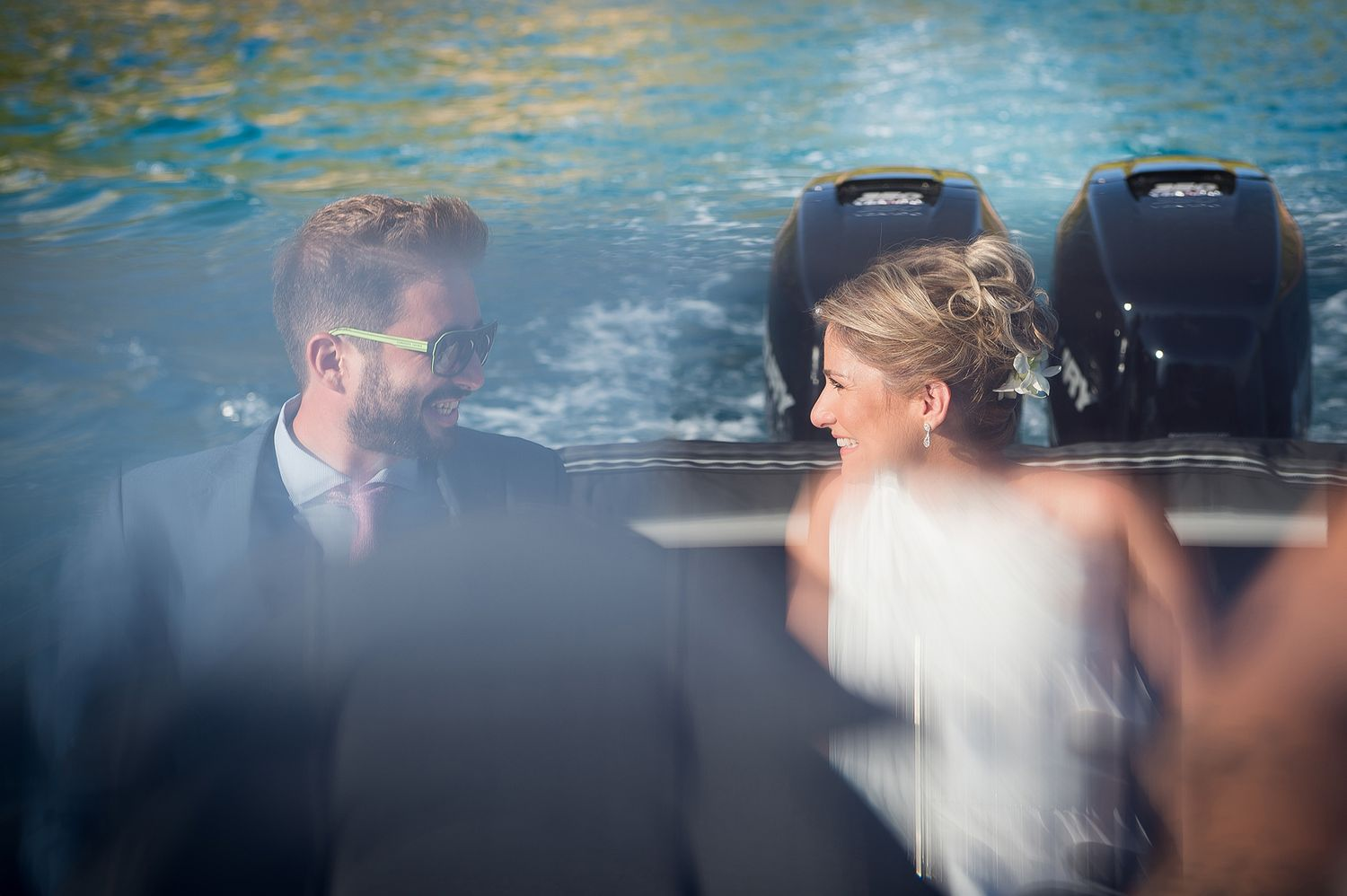 bride looks to her brother while being in the boat which transfers them to wedding ceremony