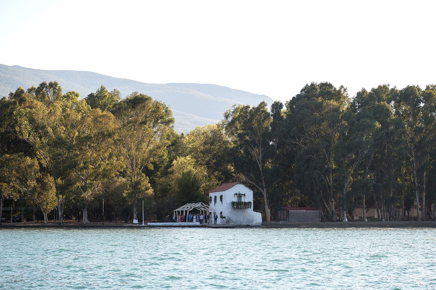view of church in poros island by the sea among the forest