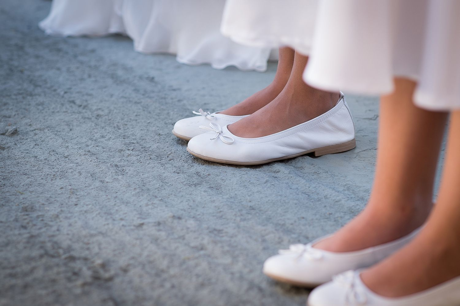 bridesmaids white ballerinas during wedding ceremony