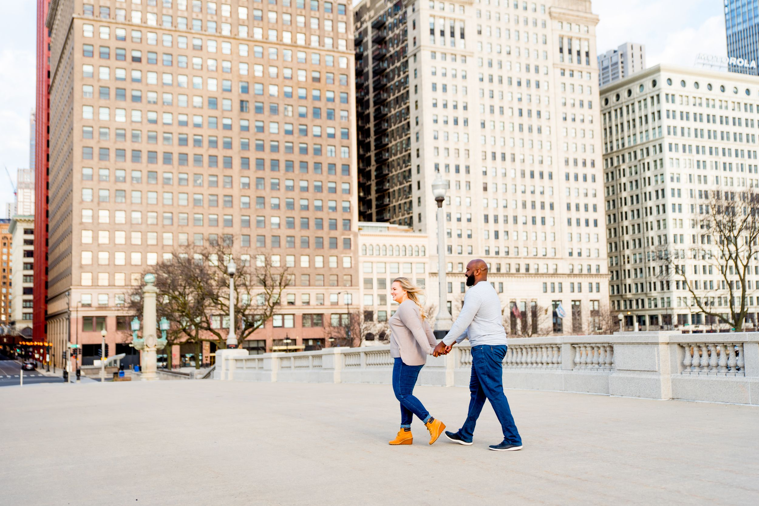 man and woman walking in front of MIchigan Ave for sunrise Chicago wedding pictures