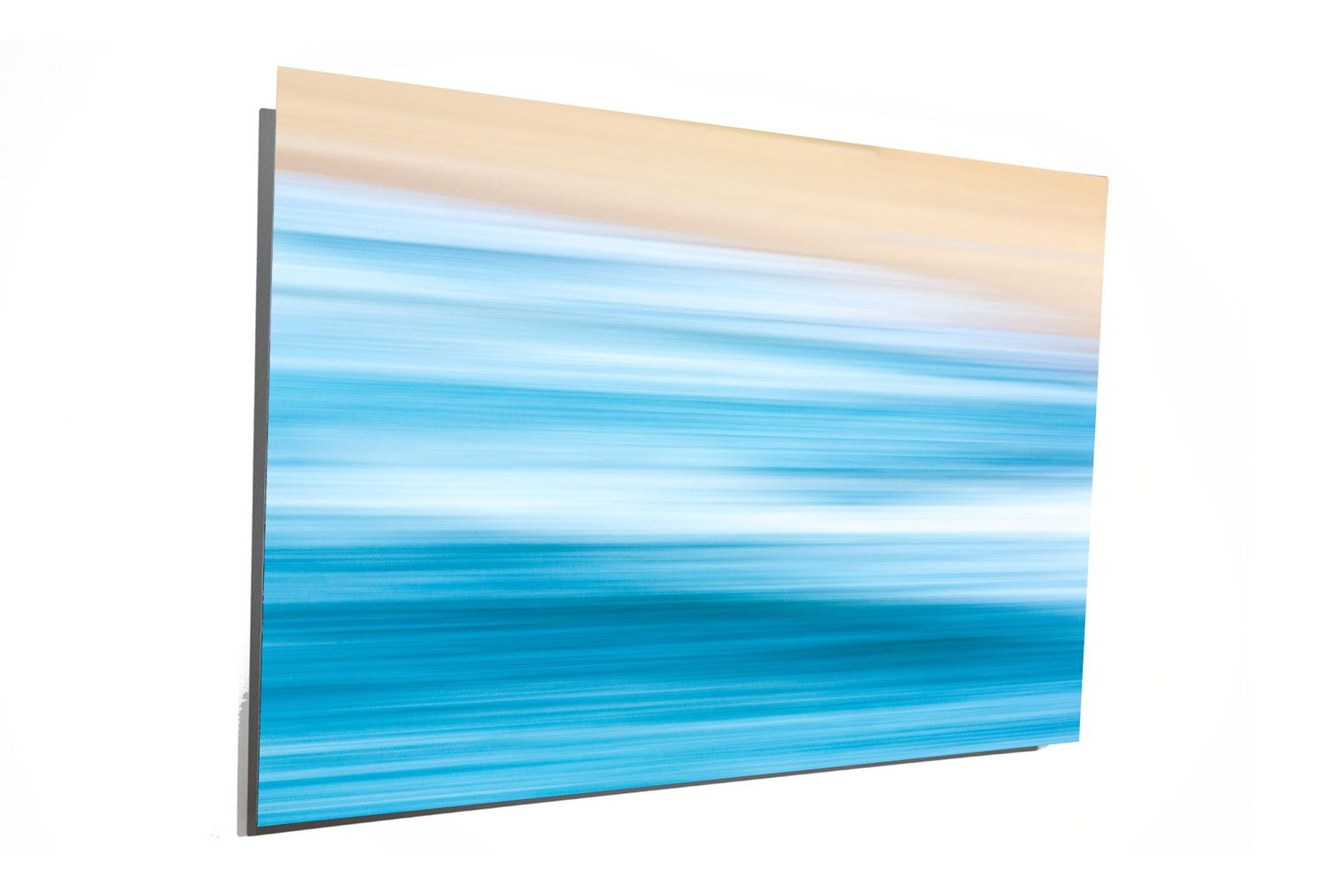 Salty Gallery offers metallic prints of its ocean imagery