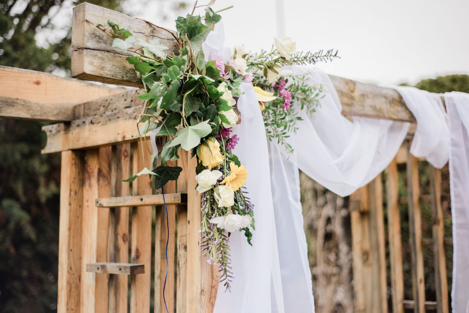 celebrate-your-heritage-on-your-wedding-day-embrace-your-culture-happy-bride-and-groom-small-wedding-arbor-floral